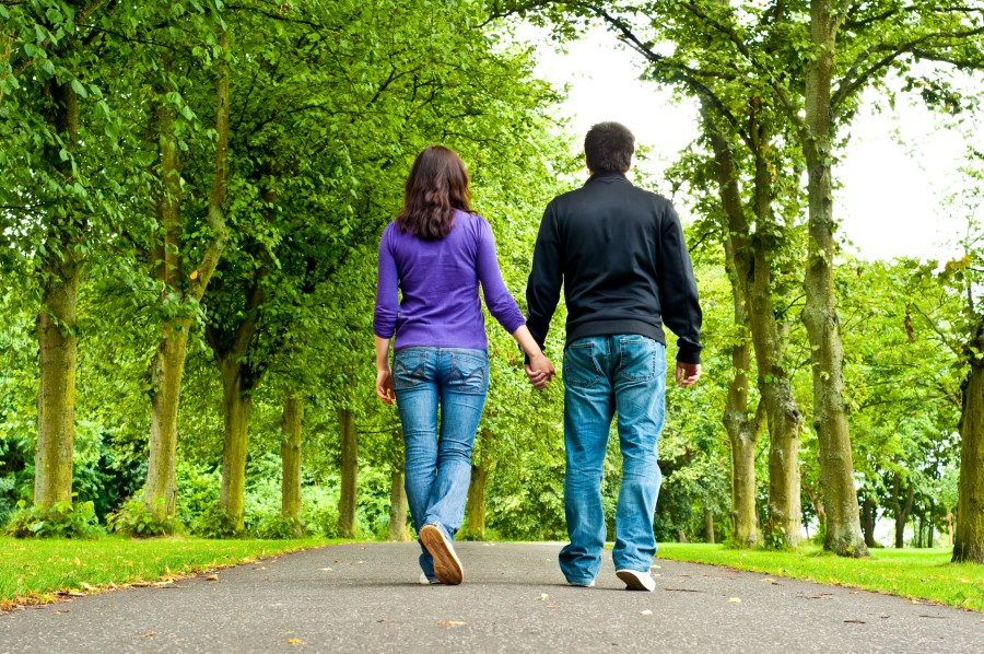 couple walking a path in a park